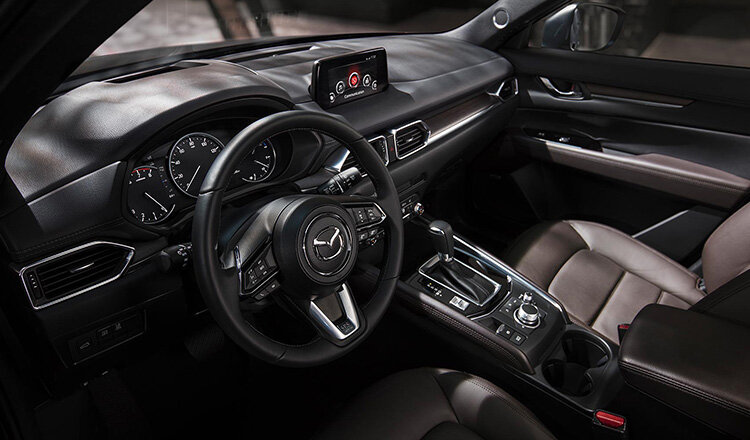 Mazda CX5 II в сравнении с Cadillac SRX II.